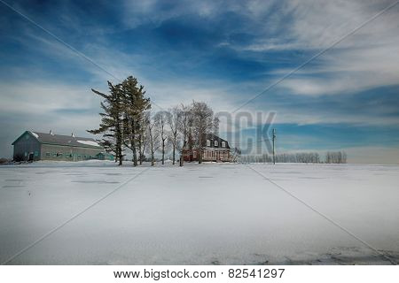 Farmhouse and building during winter season in Beauce area near Quebec, Canada