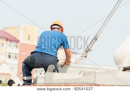 Builder working on residental house construction