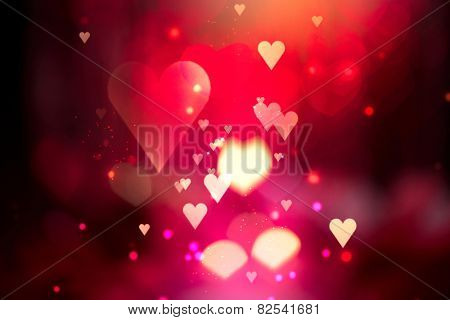 Glowing Red hearts love background. St. Valentine's Day holiday abstract glowing blurred bokeh. Defocused blinking heart shaped lights. Valentine Hearts Abstract Wallpaper. Backdrop