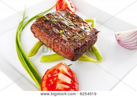 Roast Fillet Served With Tomato