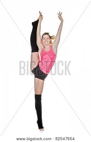 young woman doing gymnastic or ballet pose