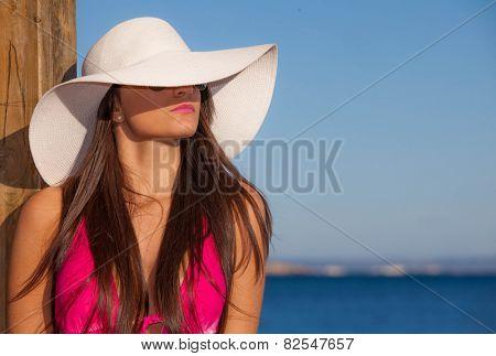summer fashion woman with big beach hat.