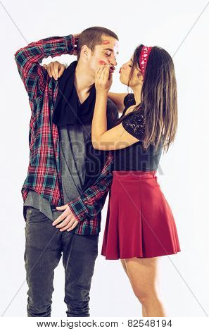 Pretty brunette latina girl stealing kisses from her boyfriend