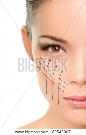 Face lift anti-aging treatment - Asian woman portrait with graphic lines showing facial lifting effect on perfect skin. Skincare cosmetic concept.