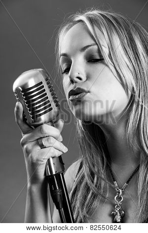 Blond Singing With Vintage Microphone