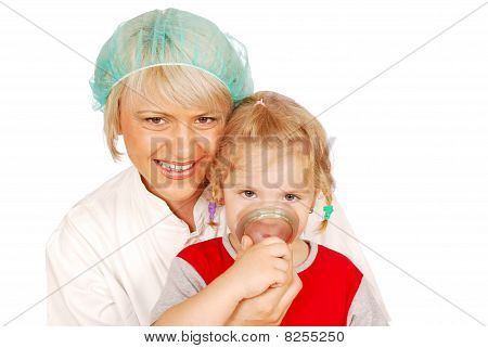 female doctor gives the child inhalation