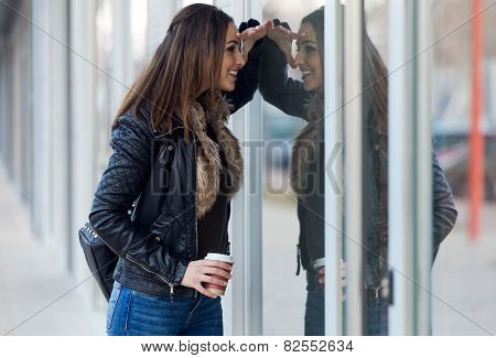 Young Beautiful Woman Looking At The Shop Window.