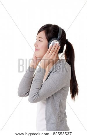 Happy smiling Asian girl with headphones, music concept portrait on white background.