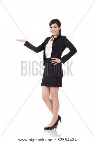 Attractive business woman introduce with hand, full length portrait on white background.