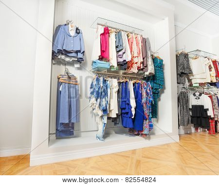 The set of children clothes hanging on hangers