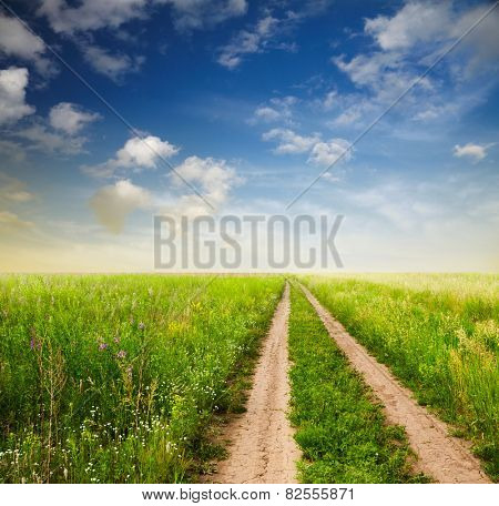 beautiful sky and road in fields