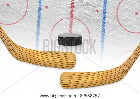 Two Hockey Sticks, Puck And Hockey Field
