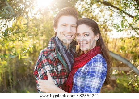Happy young couple outside on a sunny day