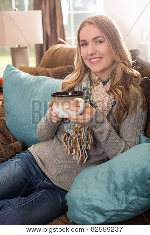 Young woman with a large mug of tea or coffee