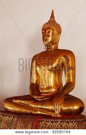 Sitting Buddha Gold Statue close up in Buddhist Temple. Wat Pho, Bangkok, Thailand