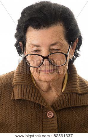 portrait of nostalgic sad grandmother looking down