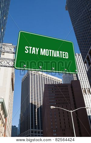 The word stay motivated and green billboard sign against new york