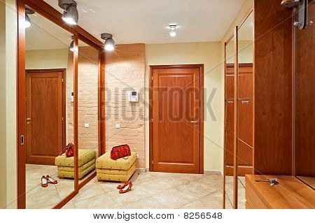 Elegance Anteroom Interior In Warm Tones With Hallstand And Mirror