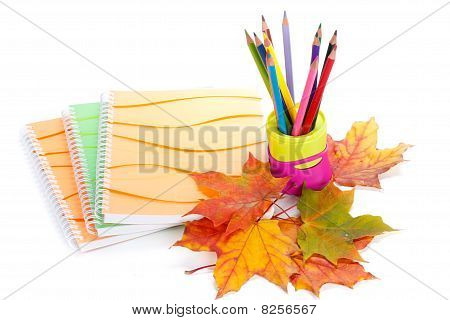 Writing-books, Multi-coloured Pencils And Autumn Leaves.