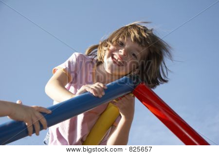 girl on climbing pole