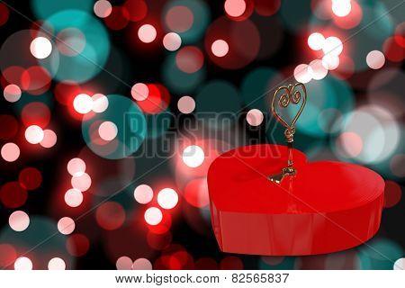 Love heart lock against digitally generated twinkling light design