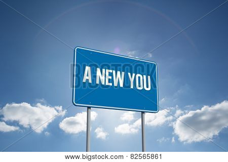 The word a new you and blue billboard sign against cloudy sky with sunshine