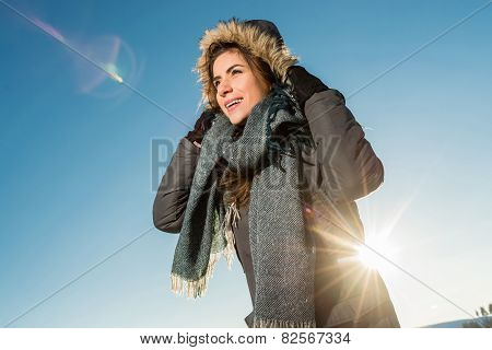 Portrait of cute smiling woman posing against nature