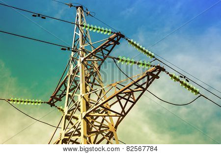 High Voltage Electric Tower Against The Blue Sky