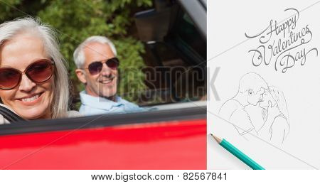 Side view of cheerful mature couple driving red cabriolet against cute valentines message