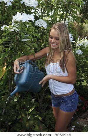 teenage girl watering
