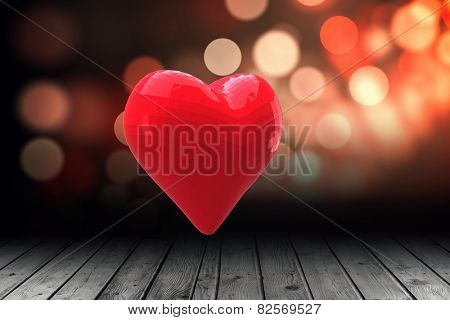 Red heart against shimmering light design over boards