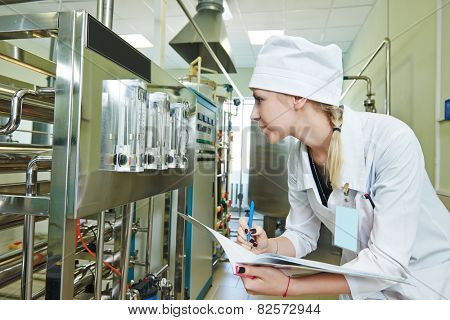 pharmaceutical man worker in water preparation production line hall at pharmacy industry manufacture factory
