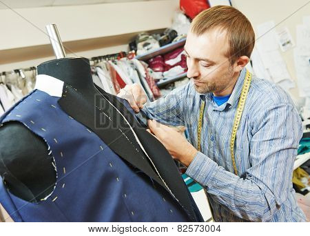 young male tailor portrait in workshop