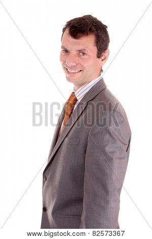 Portrait of a businessman standing against isolated white background