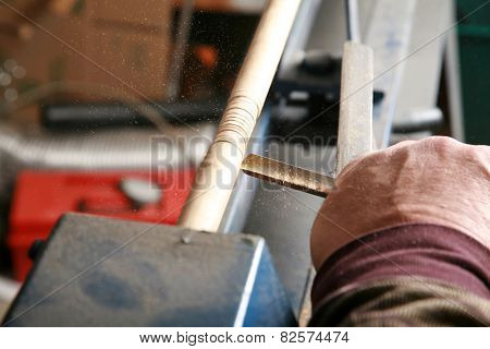 A wood worker works on a project on his lathe. Lathes are used by wood workers and metal workers for all sorts of projects around the world. Wood Working is a business and a hobby enjoyed by millions