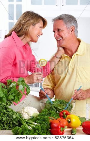 Romantic Senior couple cooking in the kitchen.
