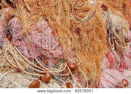 Pile of fishing nets with chords and buoys