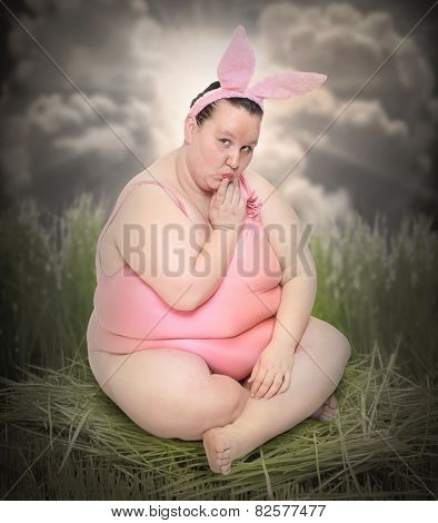Crazy Easter postcard with overweight woman as a funny Easter Bunny.