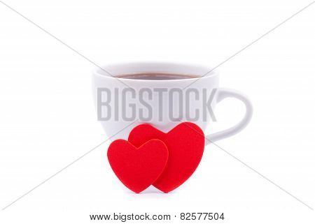 Cup Of Coffee And Two Red Hearts On A White Background.