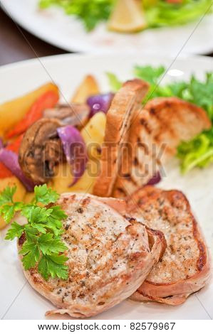 Pork chop with vegetable at plate