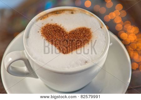 Coffee cup with milk and heart shape