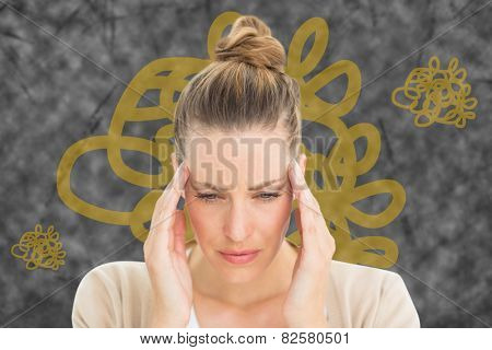 Woman with headache against squiggly line