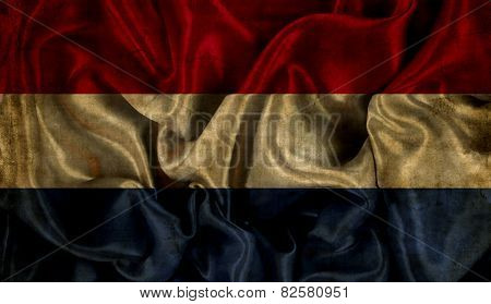 Netherlands flag background with folds and creases and a grunge effect