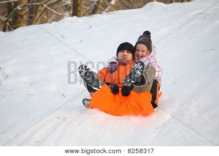 Father And Daughter Having Fun In Snow