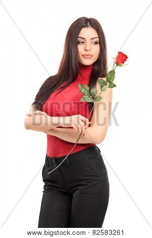 Vertical shot of an attractive woman holding a red rose isolated on white background