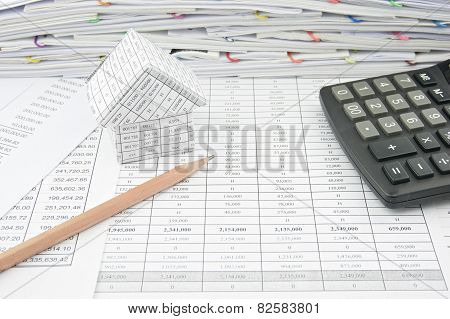 Brown Pencil Near House And Calculator On Finance Account