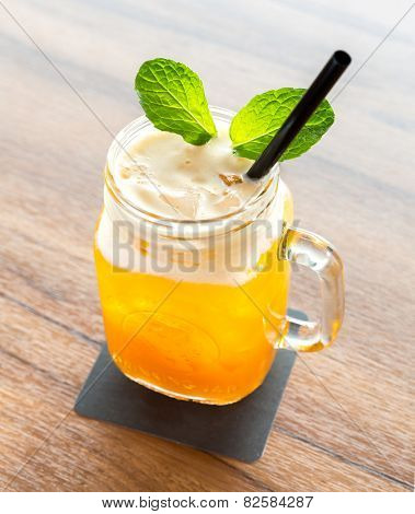 glass of Ice Passionfruit tea with mint