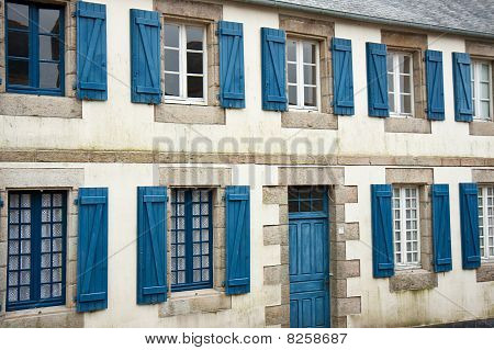 Facade Of Traditional Breton Houses With Blue Shutters In France