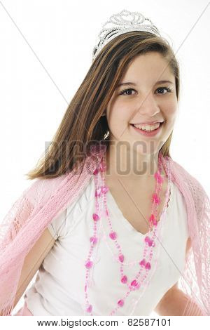 A beautiful teen girl happily wearing a crown, lacey pink shawl and a silver crown.  On a white background.
