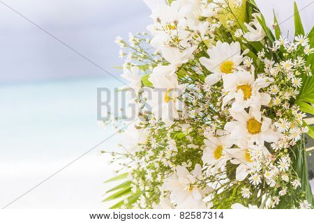 white flowers on wedding cabana on natural outdoor background